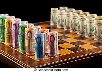 Money making strategies concept - Euros and dollars on chess...