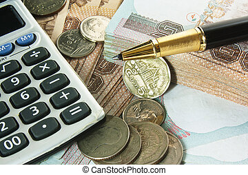 Money, pen and calculator