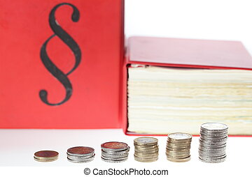 money pile - a pile of money coins with law books in...