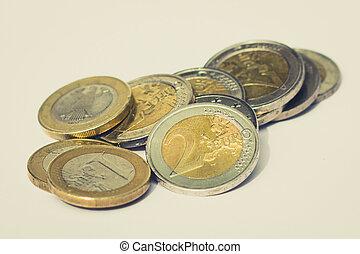money - pile of euro coins on white background