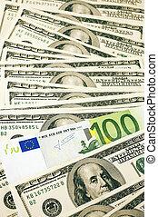 Money pile - One hundred dollars pile and one hundred euro.