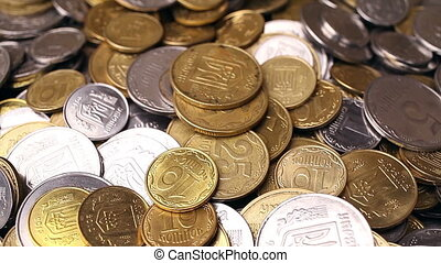 Money rotate on the table. Bills and coins. Close-up....