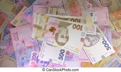 Money rotate on the table. Denominations. Dollar and hryvnia