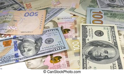 Money rotate on the table. Denominations. Dollar and hryvnia...