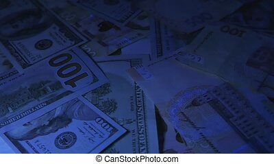 Money rotate on the table. Denominations. Dollar and...