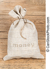 Money sack on a wooden table