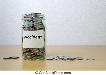 Money saving for car accident in the glass bottle