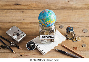 Money savings in a glass jar on wooden background, Travel concept
