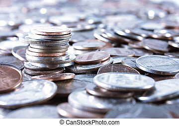 Money - Stack of coins in a sea of coins