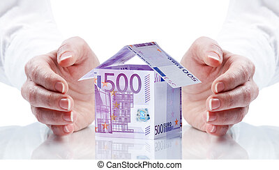 money - House made of money isolated on white background