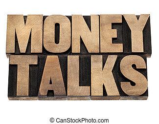 money talks in wood type - money talks - financial concept -...