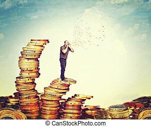 money talks - man on coin piles speak about money