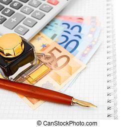 Money, the calculator, pen on a notebook.
