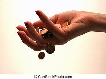 Money through finger - Coins slipping through a woman's...