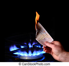 Money to burn! energy cost concept of burning a note on a gas fire