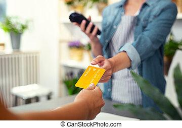 Selective focus of a debit card - Money transaction....