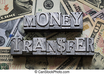 money transfer concept made from metallic letterpress type...