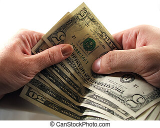 Money transfer - A few bills being transfered from one...