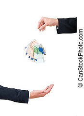 money transfer - A stack of euro\'s falling from one hand...