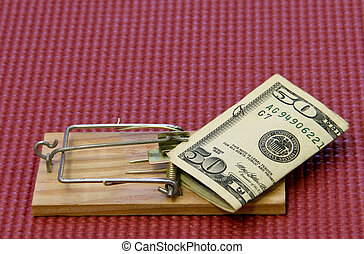 money trap - fifty dollar bill on a mouse trap with a mat...