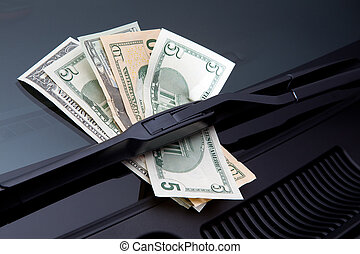 Money under windshield wiper - Money stuck under a...
