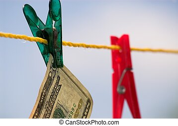 Money washing - 20-dollar paper currency is hanging on...