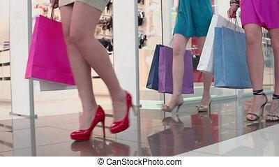 Money Waste - Cropped shot of female legs walking leisurely...