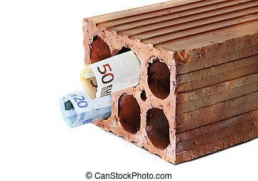 money within a brick symbolizing the mortgage crisis