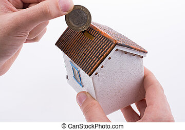 Moneybox in the shape of a model house