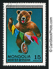 Bear riding wheel - MONGOLIA - CIRCA 1973: stamp printed by...
