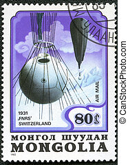 """MONGOLIA - CIRCA 1982: A stamp printed in Mongolia shows stratosphere balloon """"FRNS"""" Switzerland 1931, series, circa 1982"""