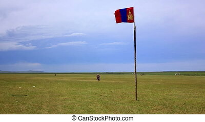 Mongolian flag waving over steppe at her flagstaff