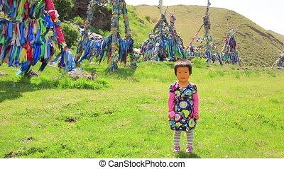 Mongolian girl posing in front of shaman Adak