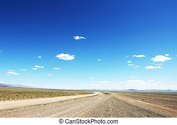 Mongolian highway - Desert road in Mongolia with dramatic...