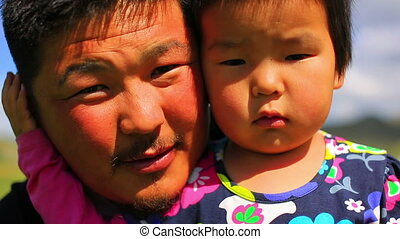 Mongolian man posing with his daughter