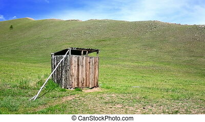Mongolian wooden squat toilet outside home, grassland of mongolia