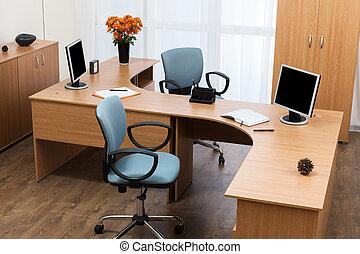 monitors on a desk