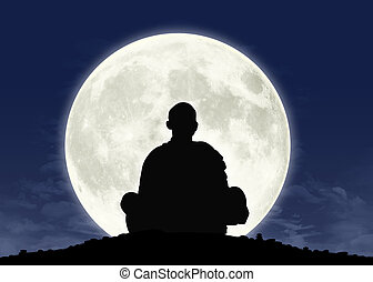 monk in meditation at the full moon - silhouette of a...