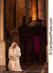 Monk in prayer