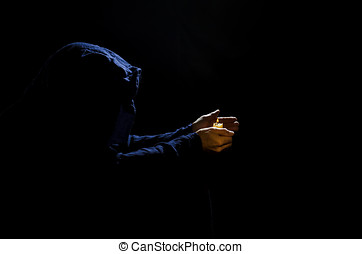 Monk with candle.