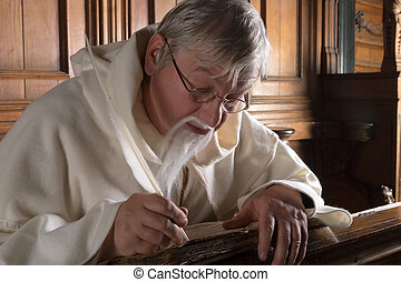 Monk with feather quill - Monk with beard writing with a...