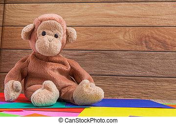 Monkey Doll on Colorful Background