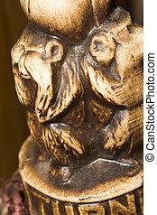 Monkey Statuette - Macro of small wooden statuette of monkey...