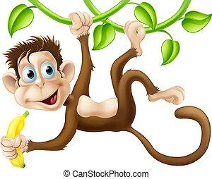 Monkey swinging with banana - A cute monkey swinging from ...