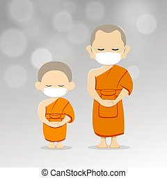 Monks and novices with white mask on airborne germs around ...