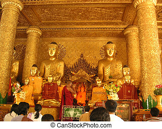 Monks and worshipper - Monk and worshippers in Shwedagon...