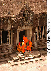 Monks at Angkor Wat - Monks Entering a Temple in Angkor Wat,...