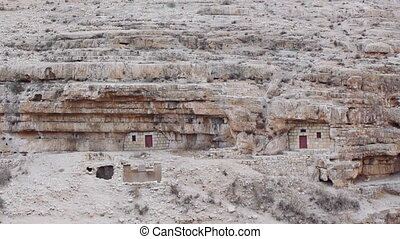 Monks' cells in the rock of Kidron valley, Saint Savas...