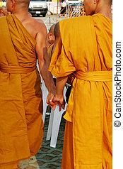 Monks holding hands