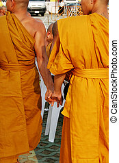 Monks holding hands